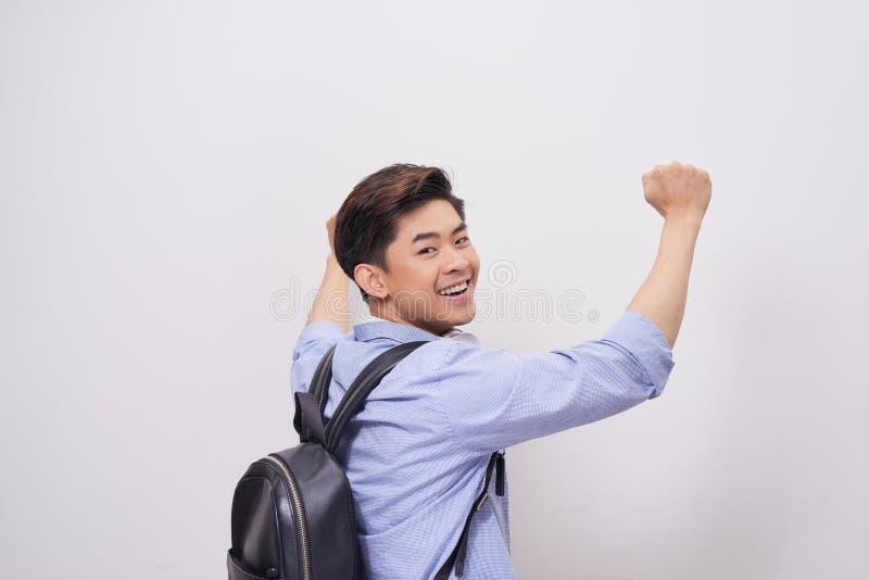 Ritratto di vista laterale dell'uomo bello sorridente su fondo bianco w fotografia stock