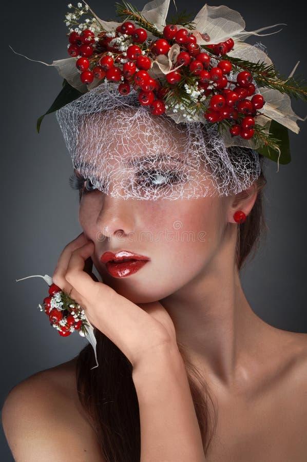 Ritratto femminile concettuale di bellezza dello studio con il rowa fotografia stock