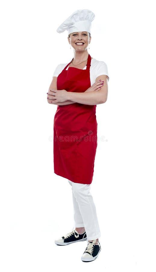 Ritratto integrale del cuoco femminile grazioso fotografia stock libera da diritti