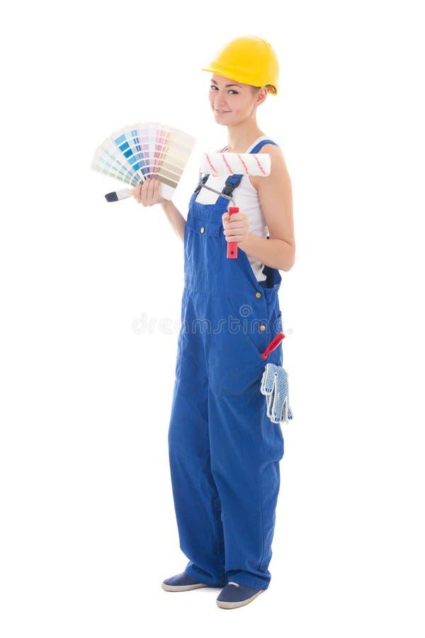 Ritratto integrale del pittore della donna in abiti da lavoro con il paintbrus fotografie stock libere da diritti