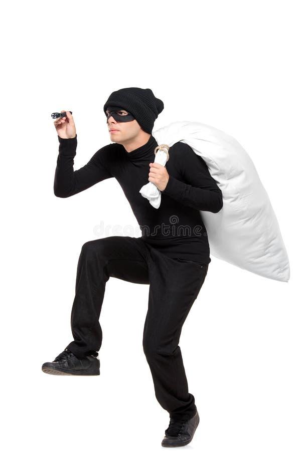 Ritratto integrale di un ladro con un sacchetto fotografia stock