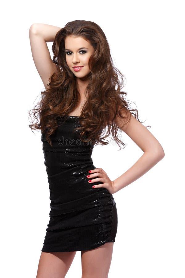 Ritratto piacevole della giovane donna in studio fotografia stock