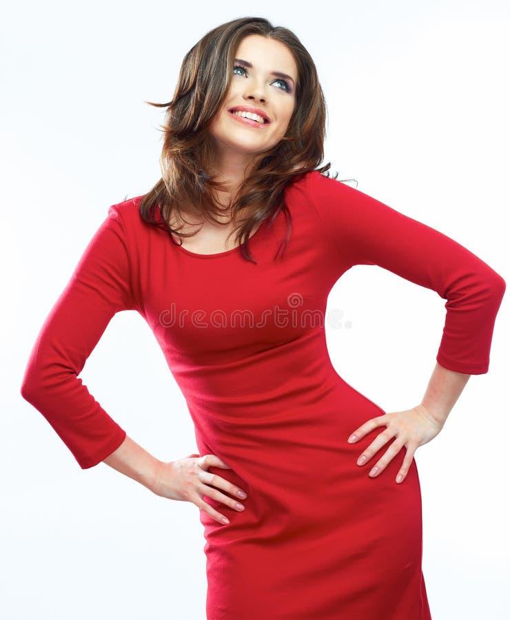 Ritratto rosso del vestito dalla donna isolato su fondo bianco Sorridere immagine stock