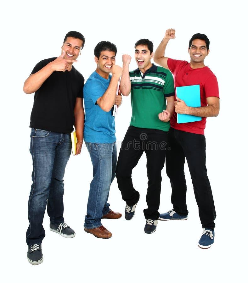Ritratto sorridente felice giovane gruppo indiano/asiatico sul backgro bianco immagine stock libera da diritti