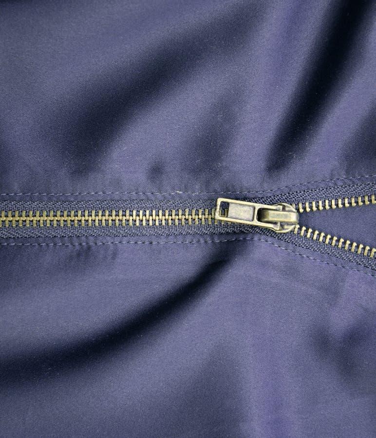 Ritssluitingsstof, de textuurachtergrond van de satijnstof stock fotografie