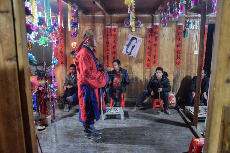 GUIZHOU PROVINCE, CHINA – CIRCA DECEMBER 2018: The ritual redeeming the vow. The ritual redeeming the vow`in a village of Guizhou accompanied by stock images