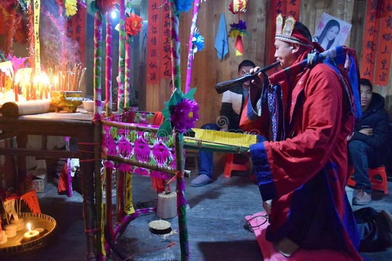 GUIZHOU PROVINCE, CHINA – CIRCA DECEMBER 2018: The ritual redeeming the vow. The ritual redeeming the vow`in a village of Guizhou accompanied by stock photography