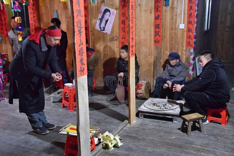 GUIZHOU PROVINCE, CHINA – CIRCA DECEMBER 2018: The ritual redeeming the vow. The ritual redeeming the vow`in a village of Guizhou accompanied by stock image