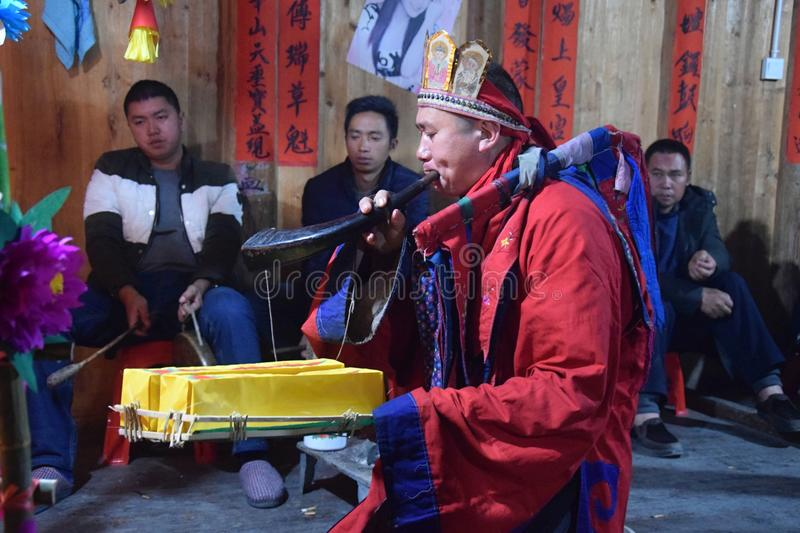 GUIZHOU PROVINCE, CHINA – CIRCA DECEMBER 2018: The ritual redeeming the vow. The ritual redeeming the vow`in a village of Guizhou accompanied by royalty free stock images