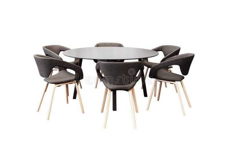 Riunione tavola rotonda e delle sedie nere dell'ufficio per la conferenza, isolante fotografia stock