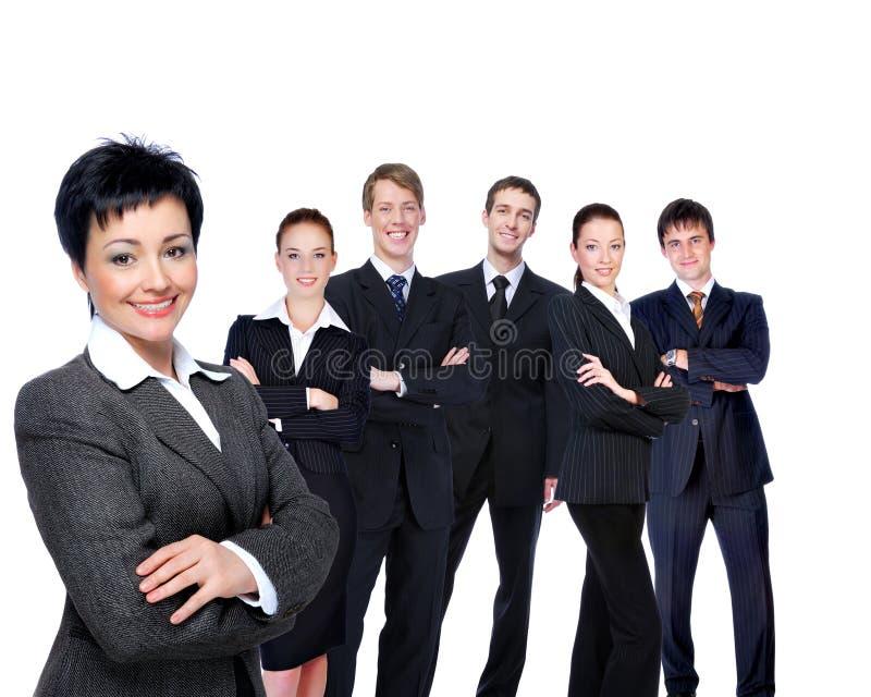 Riuscita donna di affari con il gruppo di lavoro. immagini stock