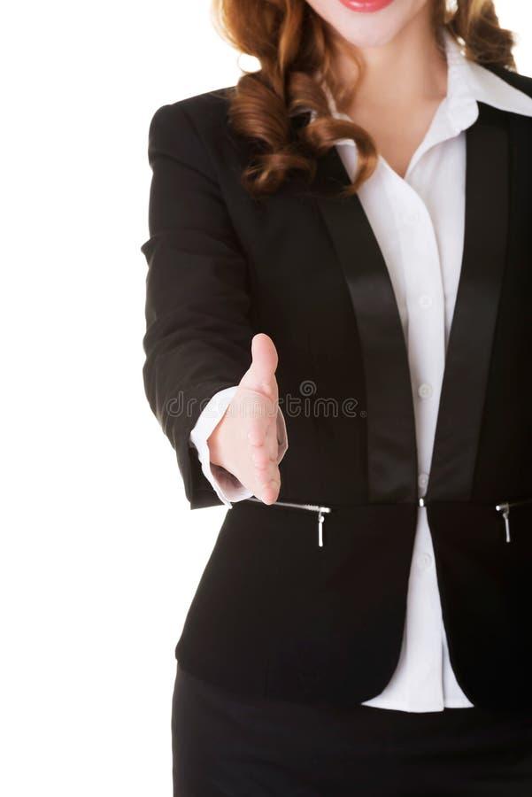 Riuscita donna di affari pronta a passare scossa fotografia stock