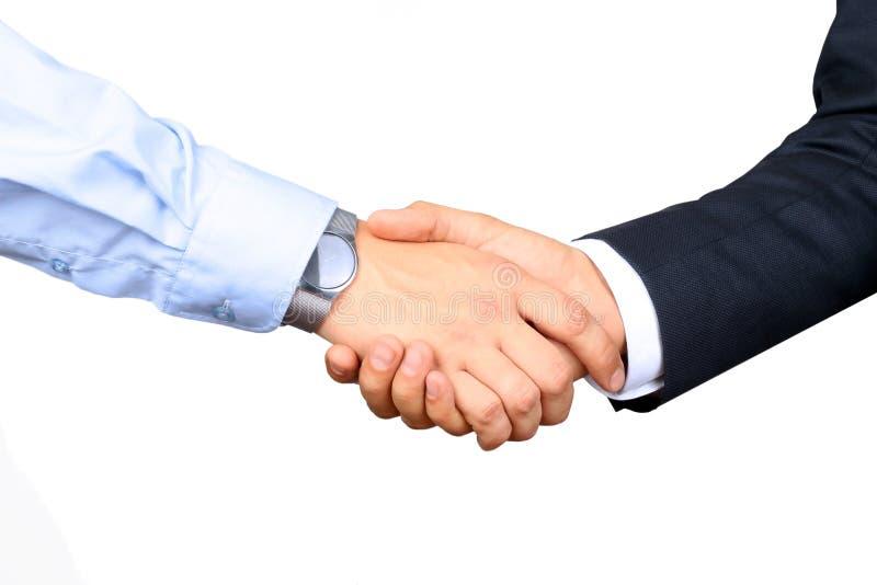 Riuscita gente di affari che stringe le mani su un fondo bianco fotografia stock