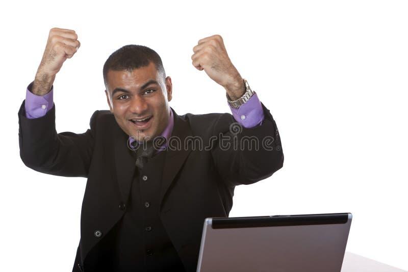 Riuscito businessmanin che incoraggia nell'ufficio fotografia stock