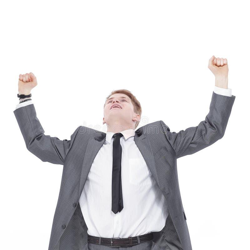 Riuscito giovane uomo gesturing molto felice di affari immagini stock