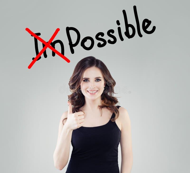 Riuscito pollice di rappresentazione della donna su Concetto possibile ed impossibile di successo, di opportunità, immagine stock