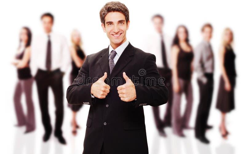 Riuscito uomo d'affari con la sua squadra fotografia stock libera da diritti