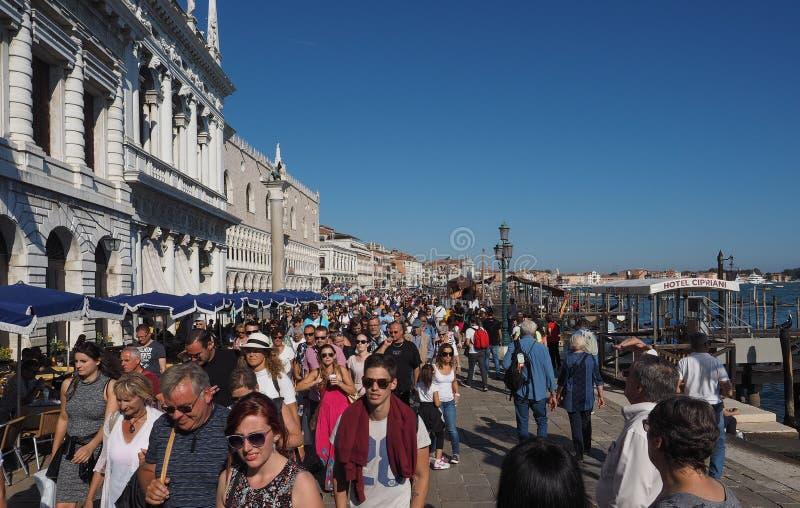 Riva degli Schiavoni in Venice. VENICE, ITALY - CIRCA SEPTEMBER 2016: Tourists in Riva degli Schiavoni waterfront promenade at St Mark Basin stock image