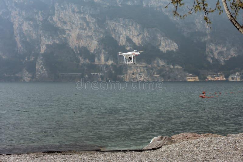 RIVA DEL GARDA, TRENTINO/ITALY - MARCH 28 : Drone hovering on th. E Shoreline at Riva del Garda Trentino in italy on March 28, 2016 royalty free stock photos