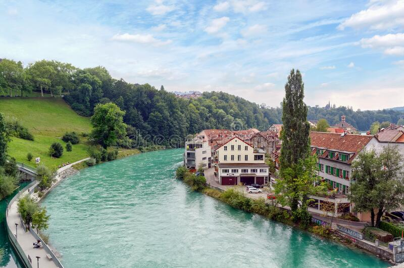 River Aare in Bern, Switzerland. View of beautiful emerald river Aare in Bern, Switzerland, with houses along the river royalty free stock images