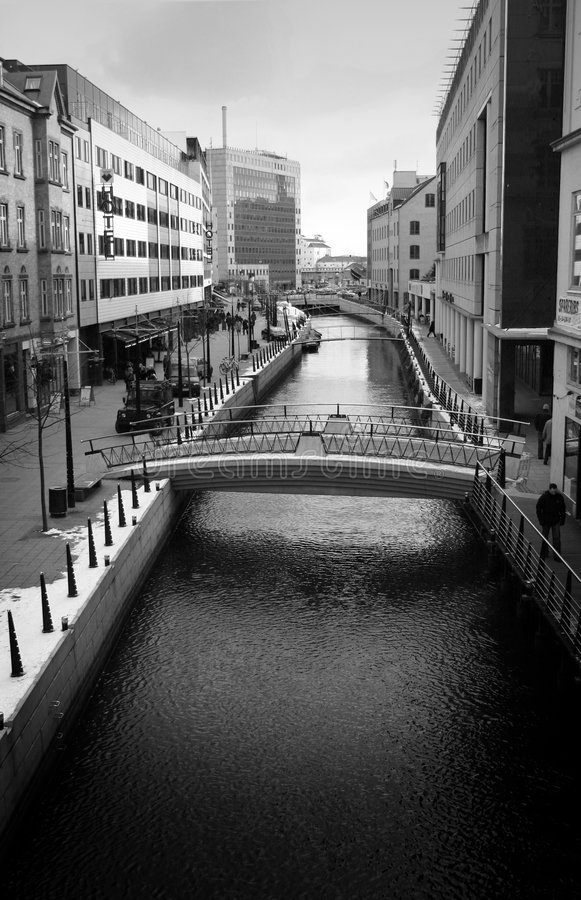River in aarhus. By a canal in aarhus city in denmark, flanked by offices stock photos