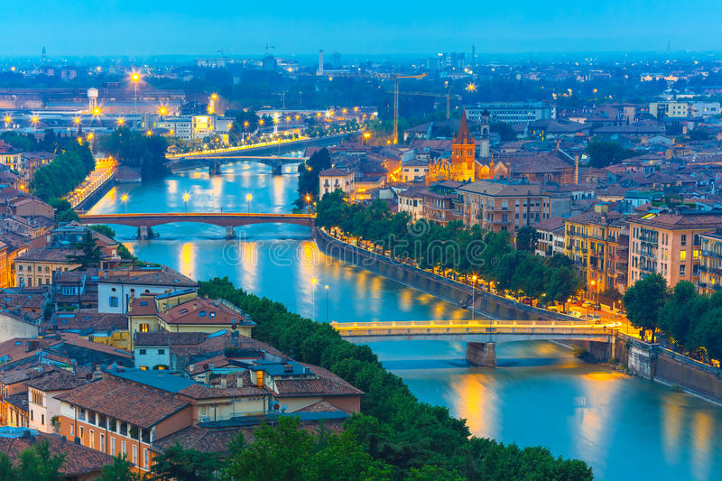 River Adige and bridges in Verona at night, Italy stock photo