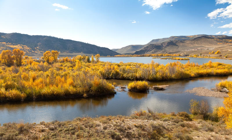 Download River, Aspen Trees And Mountains In Autumn Stock Image - Image: 21553005