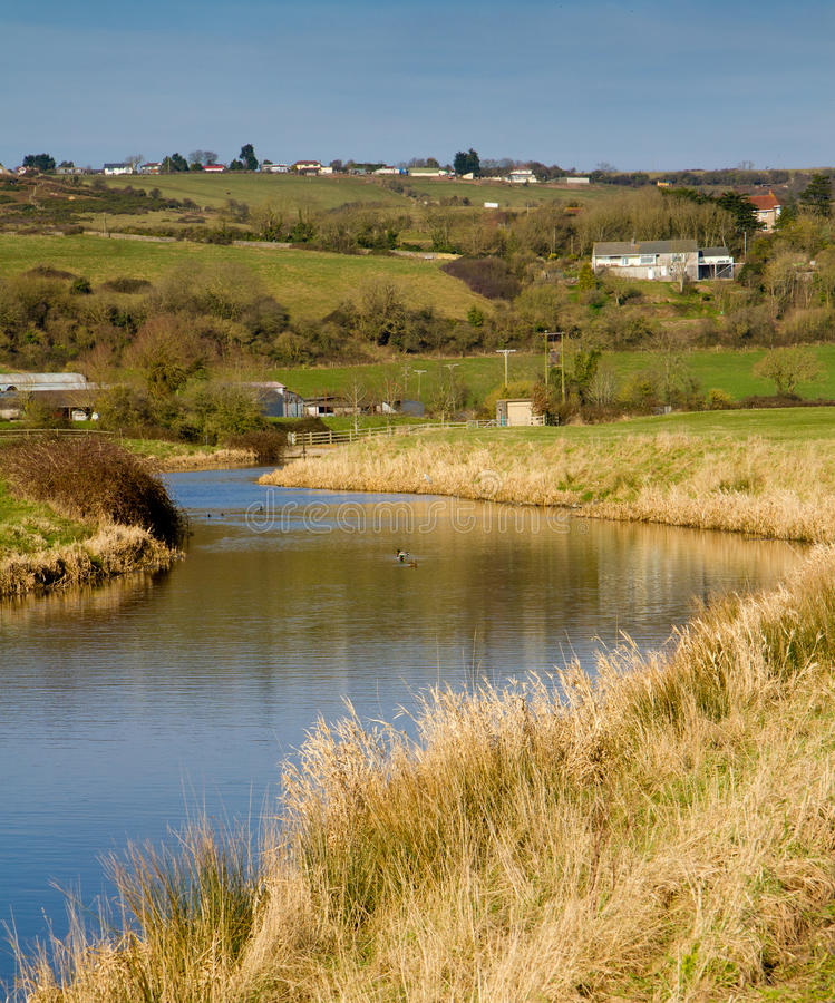 River Axe in Somerset England. The River Axe in Somerset England located near to the A370 Bleadon and Weston-super-mare royalty free stock photography
