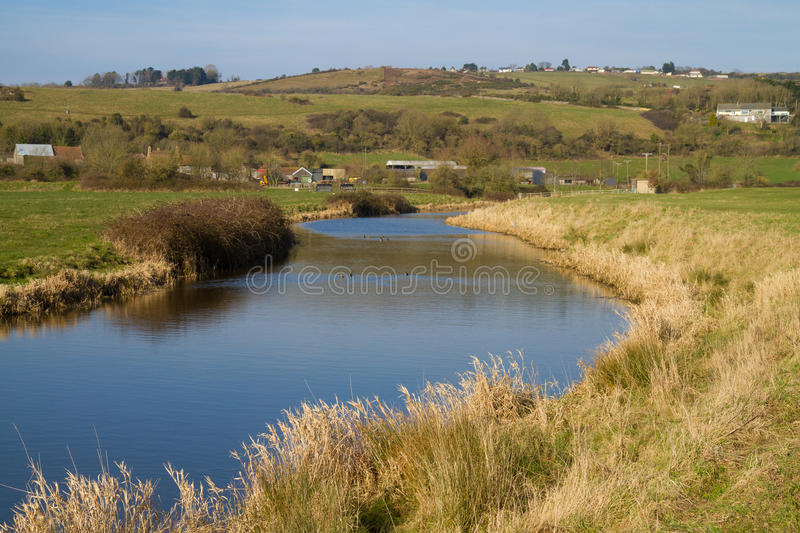 River Axe Somerset England. The River Axe in Somerset England located near to the A370 Bleadon and Weston-super-mare stock photography