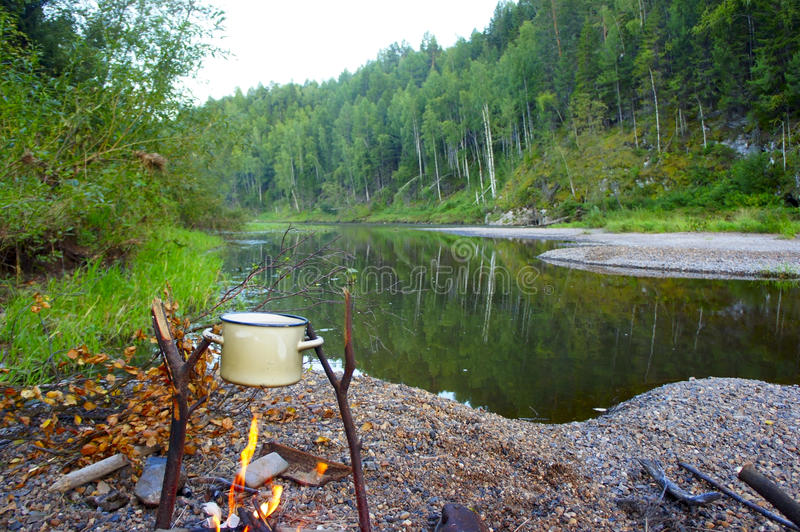 On the river bank with a fire cooking royalty free stock photos