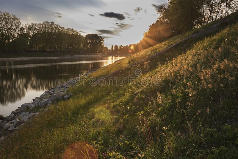 River bank at sunset royalty free stock photos