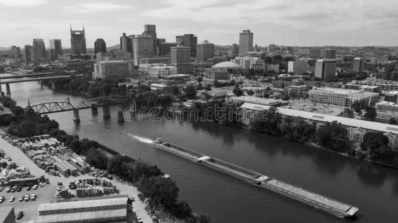 A River Barge Passes along the Waterfront of Nashville Tennessee. Classic black and white representation of an aerial view in the Capital city of Nashville royalty free stock photography