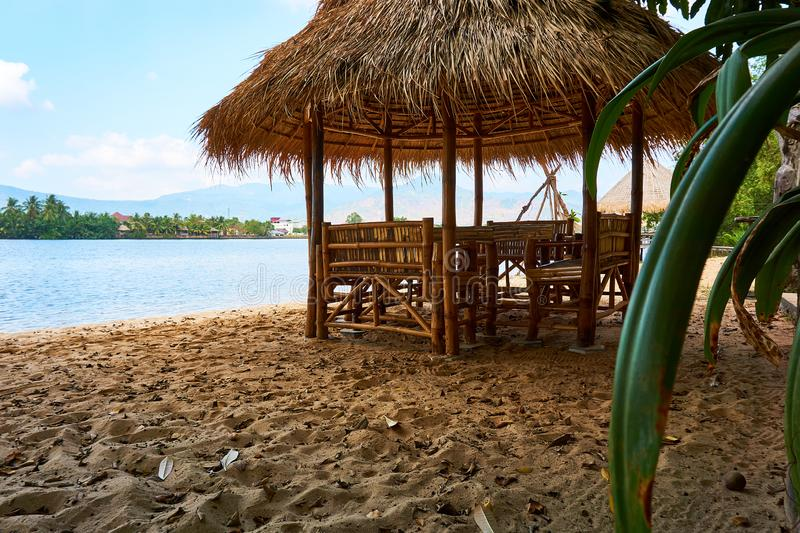 River beach with straw hut in Kampot Cambodia. Sunny day travel royalty free stock photo
