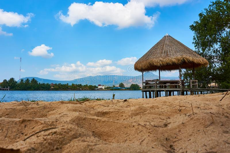 River beach with straw hut in Kampot Cambodia. Sunny day travel royalty free stock photography