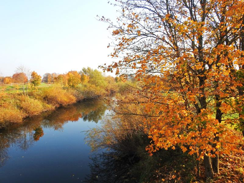 River and beautiful autumn trees, Lithuania stock images