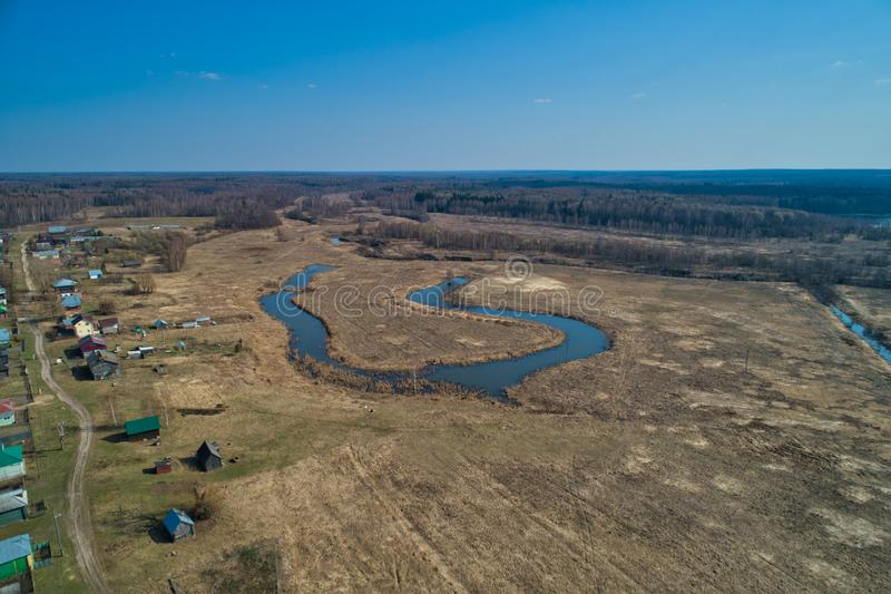 River bend in the shape of a horseshoe. The view from a great height. Early spring, landscape with dead grass royalty free stock images