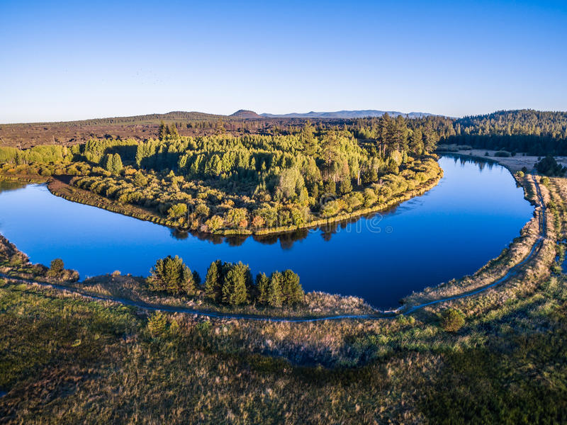 A River Bend at Sunset with Trail. A Bend in the Deschutes River near Bend, Oregon stock photos