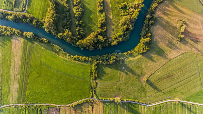 River bend surrounded by fields from bird`s eye view. Ljubljanica, Slovenia stock image