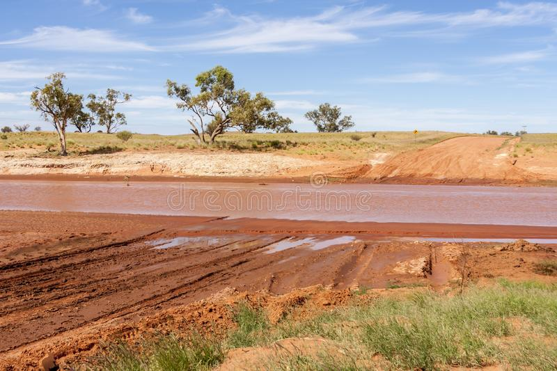 River blocked the road through Australian outback, Australia Northern territory.  royalty free stock images