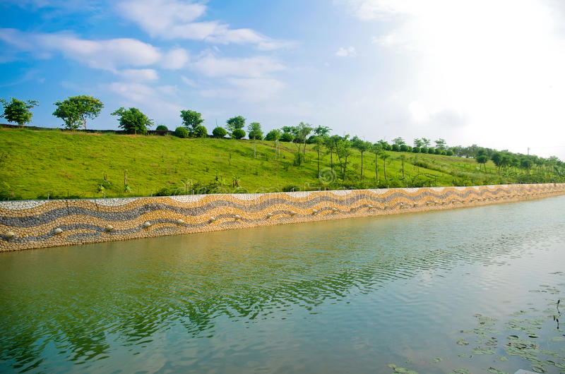 River. Blue sky and green embankment royalty free stock image