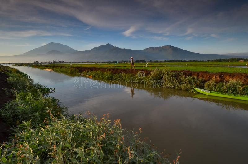 River and the boat with mountain background. Alone, tree, night, landscape, plant, nightscape, cloud, field, sunrise, rice royalty free stock photos