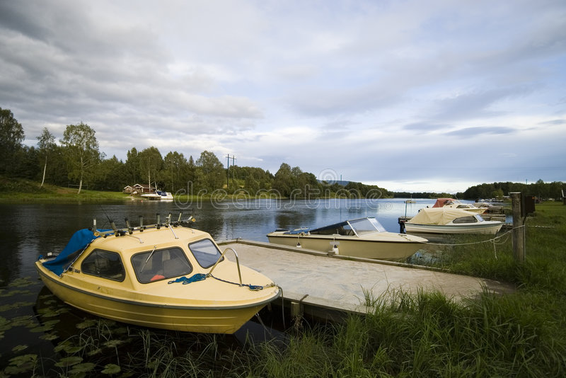 River boats. Some river boats moored to a bank. Norway, Telemark county stock photos