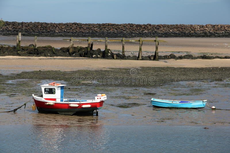 River Boats. View across from the banks of the river Croquet with small boats, at low tide royalty free stock photo