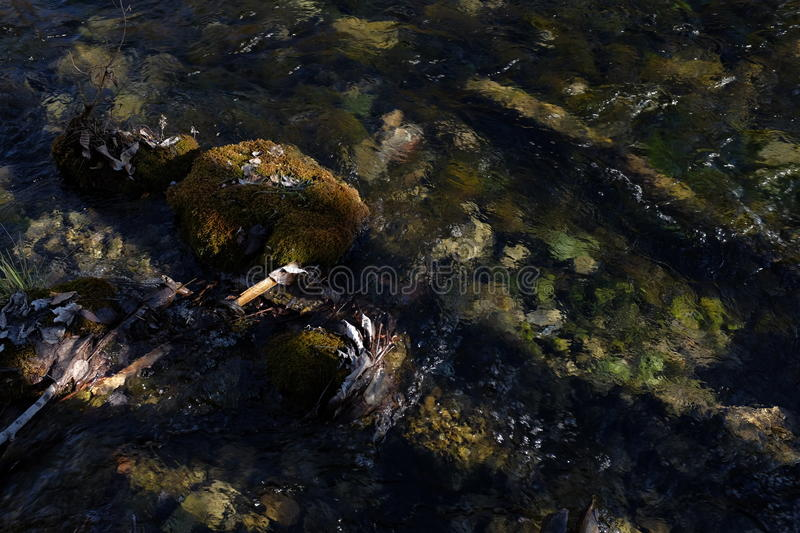 River bottom background. A scene captured at Jiuzhaigou, Sichuan China. Water is clear that the river bottom could be seen. The flowing water also produce a royalty free stock images