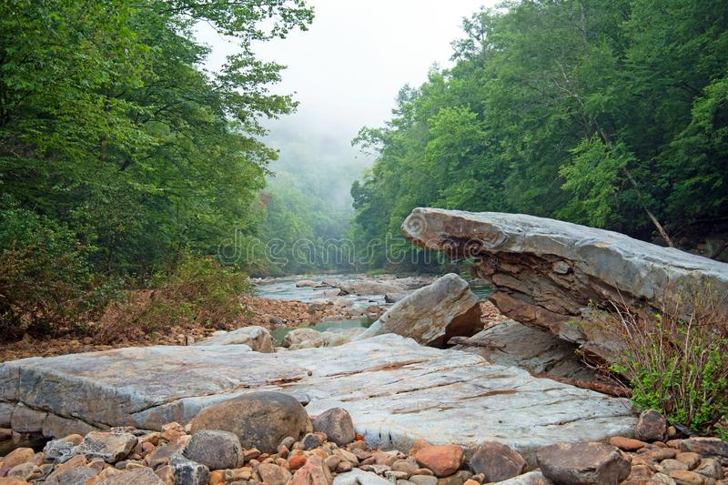 River bottom with boulders stacked royalty free stock photo
