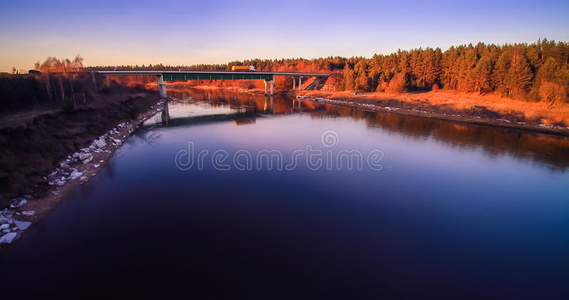 River and bridge from bird's view. River Neris aerial view at sunset light, Lithuania royalty free stock image