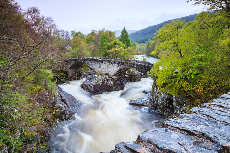 River and bridge in mountain landscape royalty free stock photos