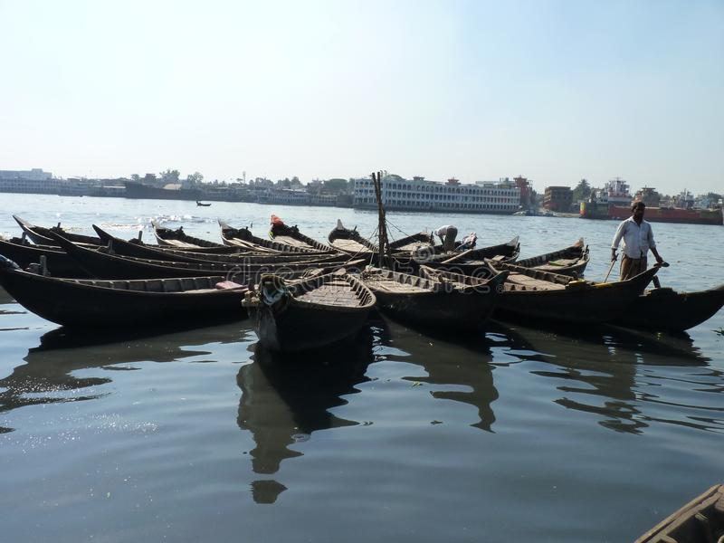 River of burigonga dhaka bangladesh. Landscape river of burigonga dhaka bangladesh.water, and natuer of beauty. sky of blue shade in river.station of boat stock photography