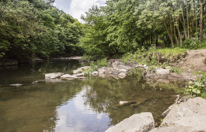 River at Burrs Country Park near Bury. Lancashire, England, UK on a sunny Summer's day royalty free stock photography