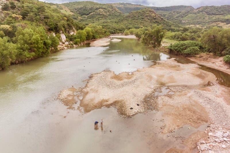 River called Rio Grande o Choluteca in Honduras. Rio Grande o Choluteca, Honduras - November 25, 2016: People in the river called Rio Grande o Choluteca in stock image